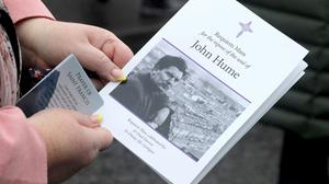 An attendee holds a Mass card at John Hume's funeral at St Eugene's Cathedral in Londonderry, Northern Ireland August 5, 2020.  REUTERS/Lorraine O'Sullivan