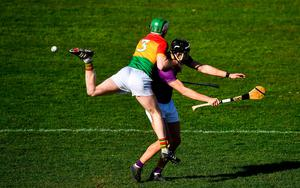 Michael Dwyer of Wexford in action against Paul Doyle of Carlow during the Allianz Hurling League Division 1 Group B match at Chadwicks Wexford Park in Wexford. Photo: David Fitzgerald/Sportsfile
