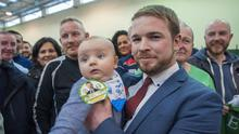 Young vote: Sinn Féin's Donnchadh Ó Laoghaire celebrates with son Fiach (4 months) as he becomes the first TD to be elected to the 33rd Dáil. Photo: Daragh Mc Sweeney/Provision