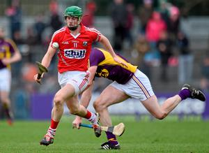 Cork's Seamus Harnedy in action against Daithi Waters of Wexford