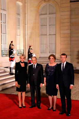 French President Emmanuel Macron (R) and his wife Brigitte Macron (L) arrive for a state dinner with Lebanon's President General Michel Aoun (2L) and his wife Nadia Al Chami at the Elysee Presidential Palace in Paris on September 25, 2017. / AFP PHOTO / LUDOVIC MARINLUDOVIC MARIN/AFP/Getty Images