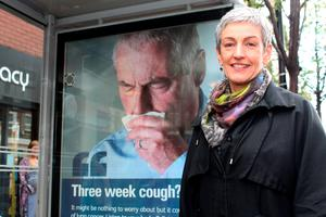 Dr Miriam McCarthy, Consultant at the Public Health Agency (PHA), at one of the PHA's 'coughing' bus shelters in Belfast, which is part of the 'Be Cancer Aware' campaign. Photo: Public Health Agency/PA Wire