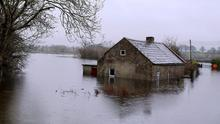 Rain over Christmas Day flooded the roads and houses in Peterswell in east Galway. Picture: Hany Marzouk