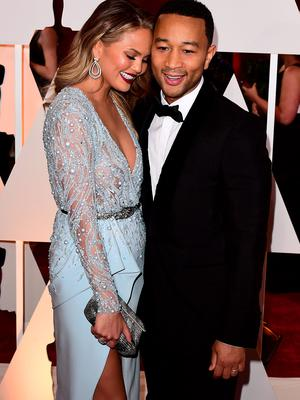 Chrissy Teigen and John Legend  arriving at the 87th Academy Awards
