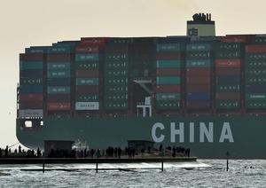 Onlookers watch from a harbour wall as the largest container ship in world, CSCL Globe, docks during its maiden voyage, at the port of Felixstowe in south east England. Photo: Reuters