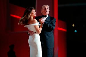 """U.S. President Donald Trump sings to the song """"My Way"""" while dancing with first lady Melania Trump during the inaugural Liberty Ball at the Washington Convention Center January 20, 2017 in Washington, DC."""