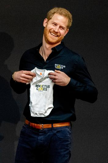 Prince Harry, Duke of Sussex is presented with an Invictus Games baby grow for his newborn son Archie by Princess Margriet of The Netherlands during the launch of the Invictus Games on May 9, 2019 in The Hague, Netherlands. (Photo by Patrick van Katwijk/Getty Images)
