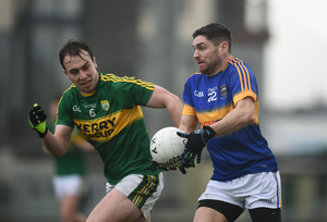 Philip Austin of Tipperary in action against Andrew Barry of Kerry Photo by Diarmuid Greene/Sportsfile