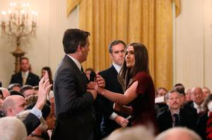 A White House intern reaches for and tries to take away the microphone held by CNN correspondent Jim Acosta as he questions U.S. President Donald Trump during a news conference at the White House in Washington, U.S., November 7, 2018. Picture taken November 7, 2018. REUTERS/Jonathan Ernst