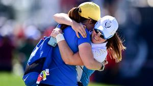 Europe's Leona Maguire celebrates with her sister Lisa after defeating United States' Jennifer Kupcho on the 15th hole during their singles matches at the Solheim Cup. (AP Photo/David Dermer)