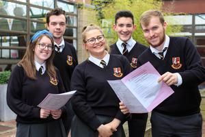 Poring over paper: Students, Shauna Doyle, John Hinch, Viola Nagy, Daniel Carey and Thomas Fludgate after finishing their accountancy exam at Pobalscoil Neasáin in Baldoyle, Dublin 13. Photo: Mark Condren