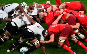 Fiji's and England's players in a scrum  in their Rugby World Cup match at Twickenham. AFP PHOTO / GABRIEL BOUYS.