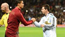 Portugal's Cristiano Ronaldo and Argentina's Lionel Messi shake hands during the International Friendly match at Old Trafford