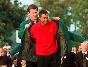 Woodsreceiving the Masters green jacket for winning the 1997 tournament Photo: JEFF HAYNES/AFP/Getty Images