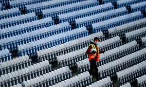 A ballboy collects a ball from the empty stand during the Leinster GAA Football Senior Championship Final match between Dublin and Meath at Croke Park in Dublin. Photo: Ramsey Cardy/Sportsfile