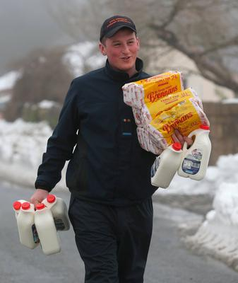 James Byrne, from Kildare Civil Defence, delivers bread and milk to people trapped by the snow during the 'Beast from the East' storm. Photo: Damien Eagers