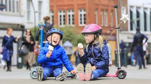 Taste of freedom: Cian (2) and Molly Dolan (5) take time to enjoy an ice cream on Grafton Street as Dublin prepares to reopen. Picture: Gerry Mooney