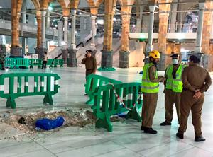 In this image released by the Saudi Interior Ministrys General Directorate of Civil Defense, Civil Defense officials inspect the damage at the Grand Mosque in Mecca after a crane collapsed killing dozens, Friday, Sept. 11, 2015. The accident happened as pilgrims from around the world converged on the city, Islam's holiest site, for the annual Hajj pilgrimage, which takes place this month. (Saudi Interior Ministry General Directorate of Civil Defense via AP)