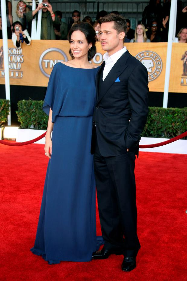 Actor Brad Pitt and actress Angelina Jolie arrive at the 15th Annual Screen Actors Guild Awards held at the Shrine Auditorium on January 25, 2009 in Los Angeles, California. (Photo by Frazer Harrison/Getty Images)