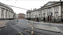 Quiet: A near deserted Dame Street which would have been at the height of the St Patrick's Day parade. Photo: Steve Humphreys