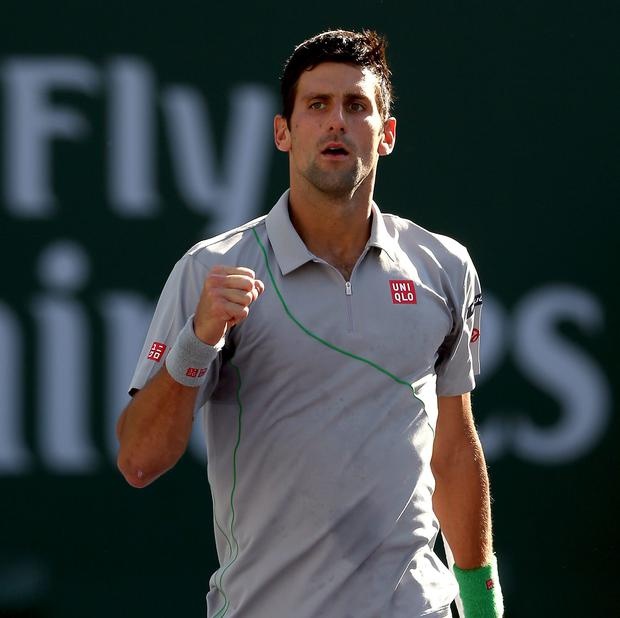 Novak Djokovic of Serbia celebrates match point against Roger Federer of Switzerland during the final of the BNP Parabas Open at the Indian Wells Tennis Garden on March 16, 2014 in Indian Wells, California. Picture: Matthew Stockman/Getty Images.