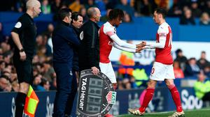 Mesut Ozil of Arsenal is replaced by Alex Iwobi of Arsenal