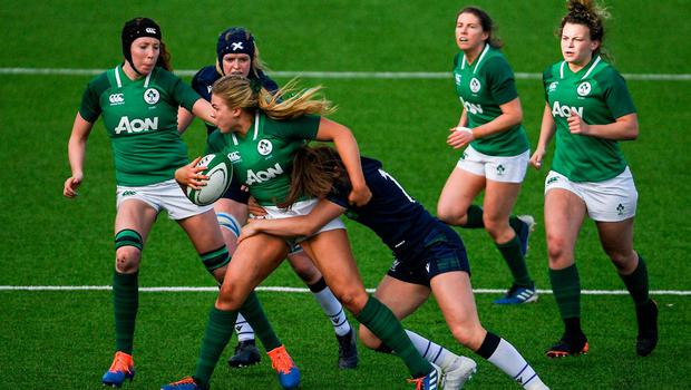 Dorothy Wall of Ireland is tackled by Rachel McLachlan of Scotland. Photo: Ramsey Cardy/Sportsfile
