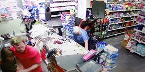 FROM CCTV....The lone raider knocks an elderly Woman over at The Glasnevin Avenue Spar. 2 of series.