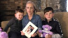 'Part of the family': Kristin Wall and her sons Dylan and Sam with a photo of Kristin and dad Robert with baby Robyn, who died in the womb. Photo: Seamus Farrelly