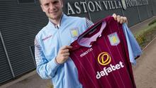 Tom Cleverley holds his new Aston Villa shirt after signing for the club on loan