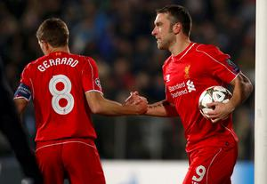 Rickie Lambert (R) of Liverpool celebrates with teammate Steven Gerrard after scoring against Ludogorets during their Champions League Group B match