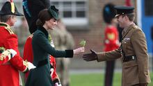Catherine, Duchess of Cambridge presents the 1st Battalion Irish Guardsmen with shamrocks during the annual Irish Guards' St Patrick's Day Parade at Household Cavalry Barracks on March 17, 2017 in London, England.  (Photo by Dan Kitwood/Getty Images)