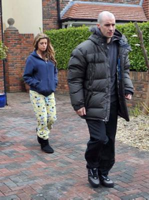 DUBLIN / IRELAND 10-04-13 Love/Hate's Nidge ( Tom Vaughan Lawlor ) and wife Trish ( Aiobhinn McGinnity ) seen leaving thier on-screen home not looking too happy.Aoibhinn was wearing PJ's covered in sheep.Earlier the crew where filming in O'Devaney Gardens a scene where one of Nidges gang is searching between some bins when another young guy pulls up on a bmx bike and shoots him a coulpe of times in the back.  PICTURED-Nidge ( tom Vaughan Lawlor ) and Trish ( aoibhinn McGinnitty PHOTOS ( JOHN DARDIS )