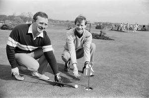 Dennis Taylor and Alex 'Hurricane' Higgins, on a putting green at the Snooker Golf Society meeting at The Belfry in April, 1985. Photo by Mirrorpix/Getty Images