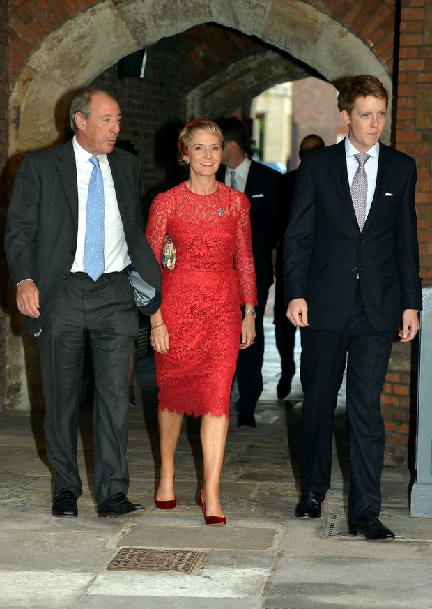 (L-R) Michael and Julia Samuel arrive with one of Prince George's godparents Hugh Grosvenor (Earl Grosvenor) at the Chapel Royal in St James's Palace, ahead of the christening of the three month-old Prince George of Cambridge by the Archbishop of Canterbury on October 23, 2013 in London, England. (Photo by John Stillwell - WPA Pool /Getty Images)