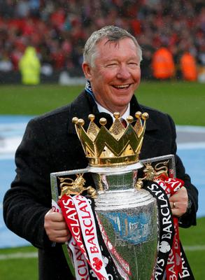 Manchester United manager Alex Ferguson poses with the English Premier League trophy at Old Trafford after his final home match in charge REUTERS/Phil Noble