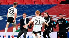 ON THEIR WAY: Joe Bryan celebrates his goal with the Fulham bench after his first goal against Brentford