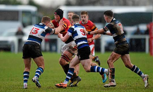Evan Mintern, CBC, is tackled by Billy O'Hora, left, Jack Lyons, centre, and Peter Hickey, Crescent College at the SEAT Munster Schools Senior Cup, Round 1, Crescent College v CBC. Tom Clifford Park, Limerick (Diarmuid Greene)