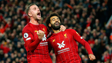 Mohamed Salah of Liverpool (11) celebrates as he scores his team's second goal from a penalty with Jordan Henderson during the Premier League match between Liverpool FC and Tottenham Hotspur at Anfield on October 27, 2019 in Liverpool, United Kingdom. (Photo by Jan Kruger/Getty Images)