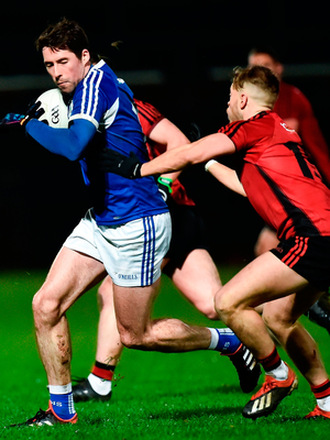 Conor Boyle of Laois in action against Jerome Johnston of Down. Photo by Oliver McVeigh/Sportsfile