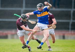 Tipperary's Dillon Quirke under pressure from Aidan Harte, left, and Cathal Mannion of Galway. Photo: Sam Barnes/Sportsfile