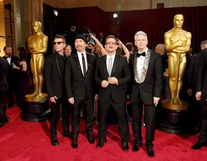 Members of the band U2 (L-R) Larry Mullen Jr, The Edge, Bono and Adam Clayton arrive  at the 86th Academy Awards in Hollywood, California March 2, 2014.      REUTERS/Adrees Latif