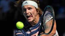 Germany's Alexander Zverev makes a backhand return to Switzerland's Stan Wawrinka during their quarter-final match at the Australian Open tennis championship in Melbourne. (AP Photo/Andy Brownbill)