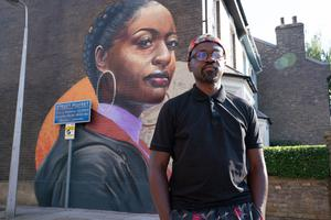 Dreph in front of his mural (Jack Barnes/BBC)