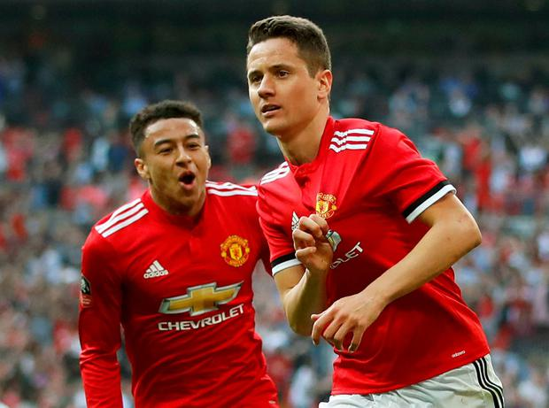 Manchester United's Ander Herrera celebrates scoring their second goal with Jesse Lingard. Photo: Carl Recine/Action Images via Reuters