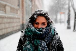 Carol, a tourist from Brazil, in snowy Berlin yesterday. Photo: Getty