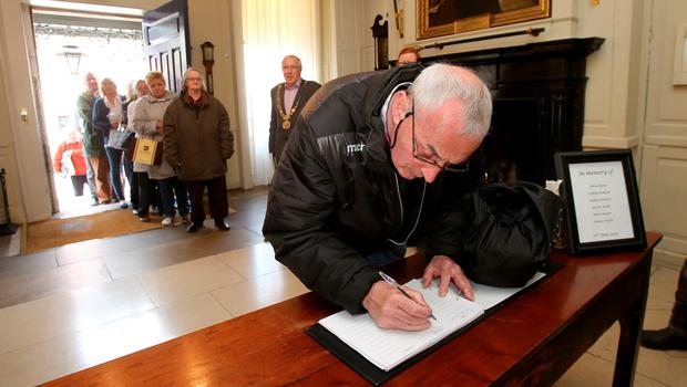 Members of the public sign a book of condolence at Mansion House in Dublin for those killed in the Berkeley balcony collapse. Niall Carson/PA Wire