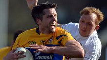 Clare's Gordon Kelly battles with Keith Cribbin of Kildare at St Conleth's Park in Newbridge. Photo: Daire Brennan/Sportsfile