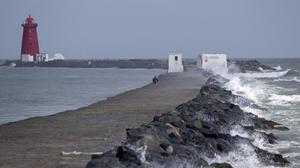 20/08/2020 Waves crash over the Great South Wall, Dublin in the wake of Storm Ellen. Picture Colin Keegan, Collins Dublin