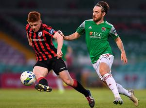 Cork City's Dylan McGlade tracks down Longford Town's Aodh Dervin during the FAI Cup first round clash. Photo: Sportsfile